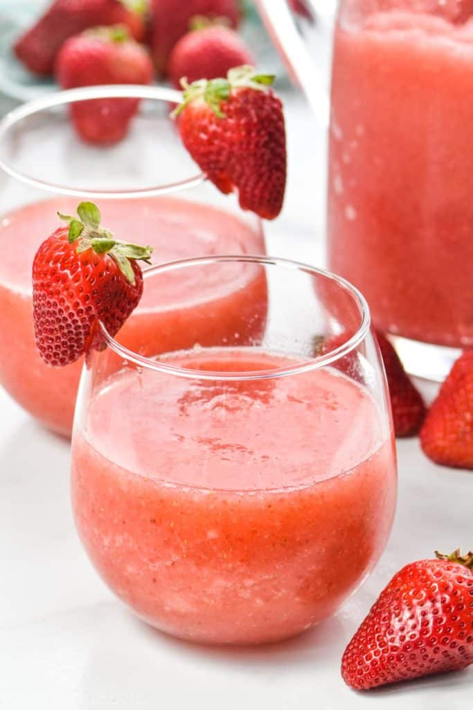 glass of strawberry wine slushie made in a blender