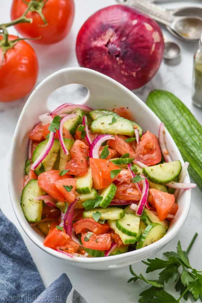 white bowl full of cucumber and tomato salad recipe