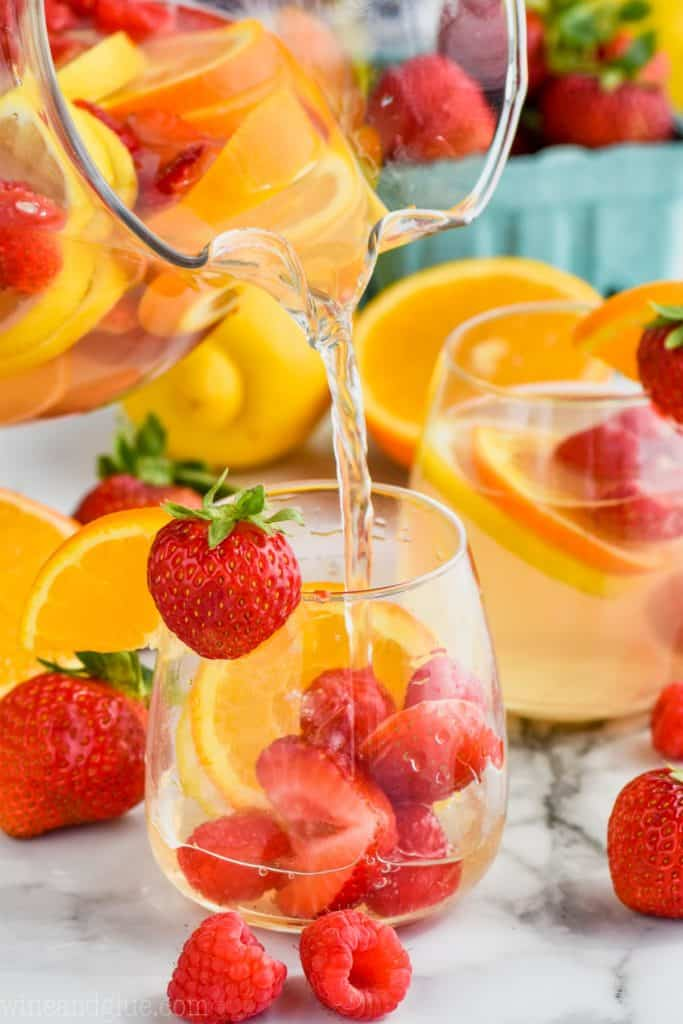 easy white sangria recipe for a crowd being poured into a glass