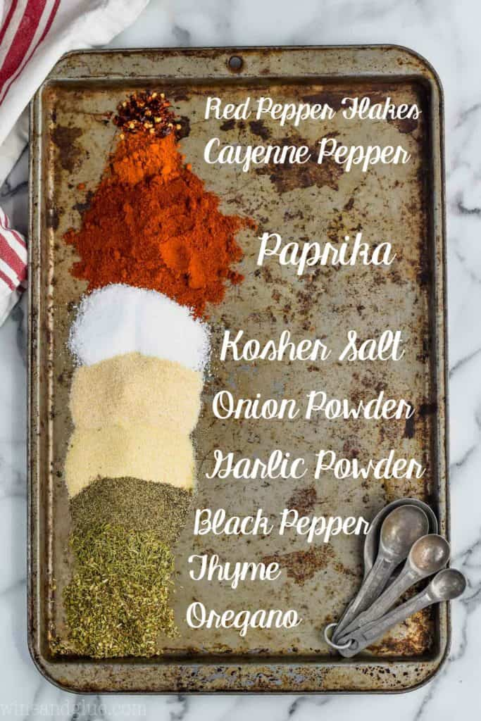 homemade cajun seasoning broken down by spices on a baking sheet and labeled