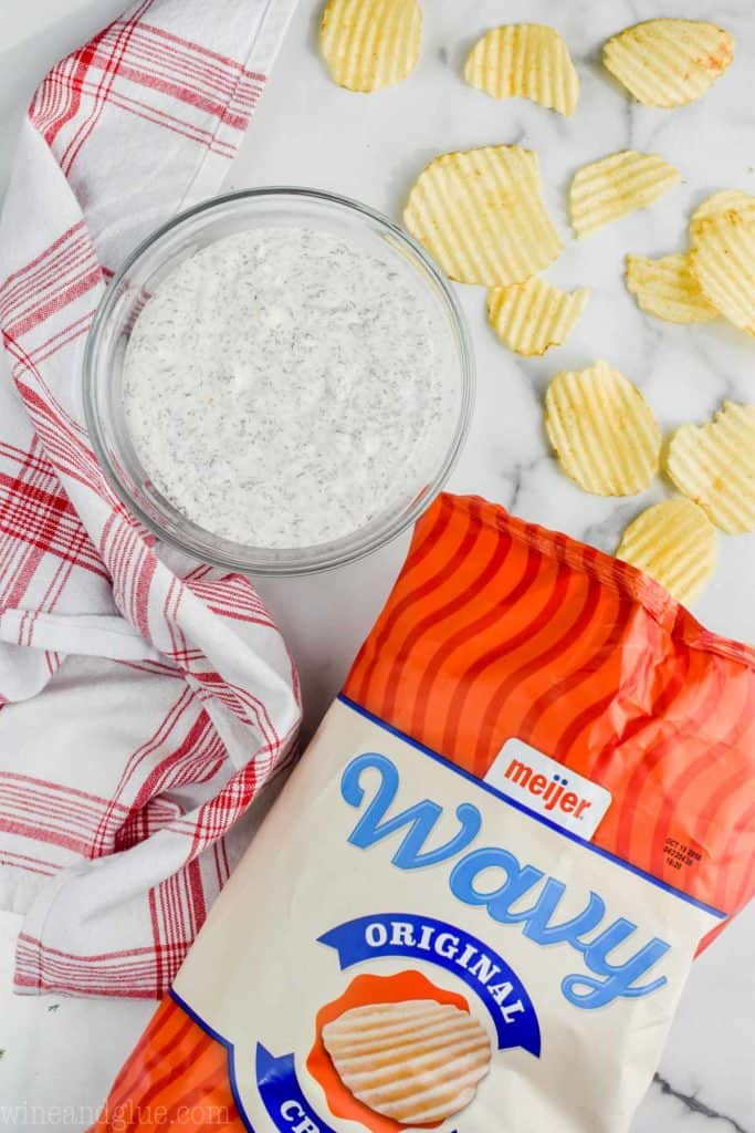 bowl of dill dip recipe sour cream with some wavy chips
