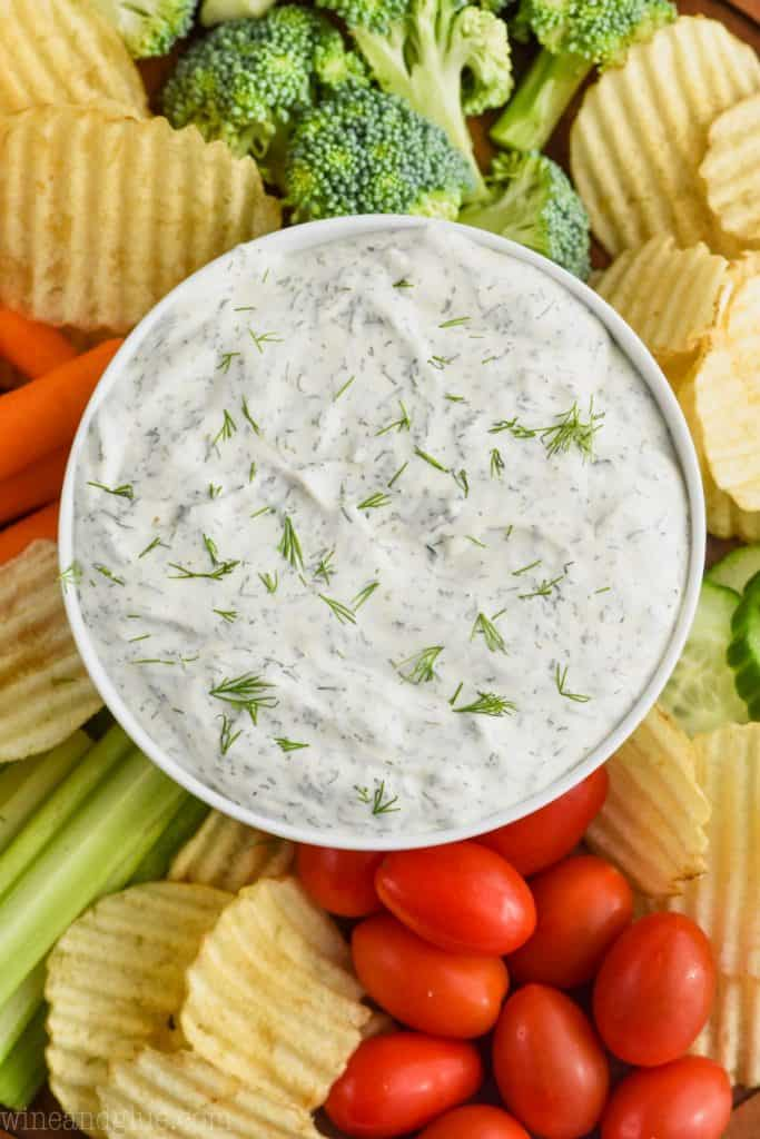 over head of dill vegetable dip recipe with chips and vegetables