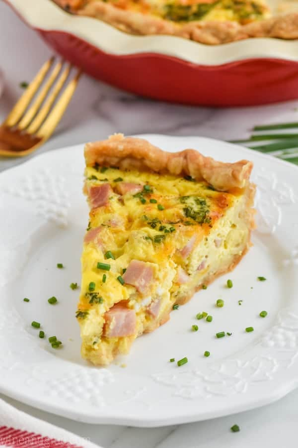 ham and cheese quiche recipe on a plate with chives