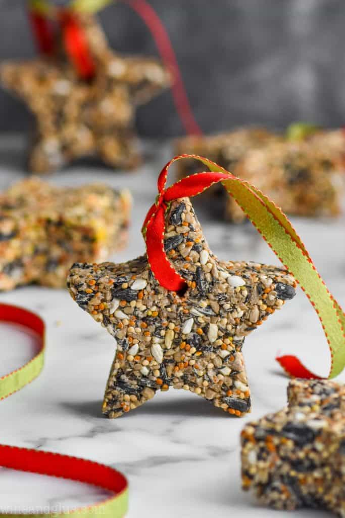 an easy to make star bird feeder with ribbon strung through it