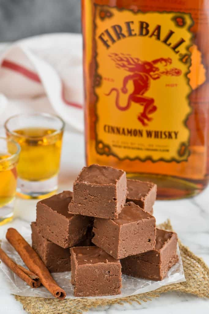 pile of condensed milk fireball fudge recipe with a bottle of fireball whiskey
