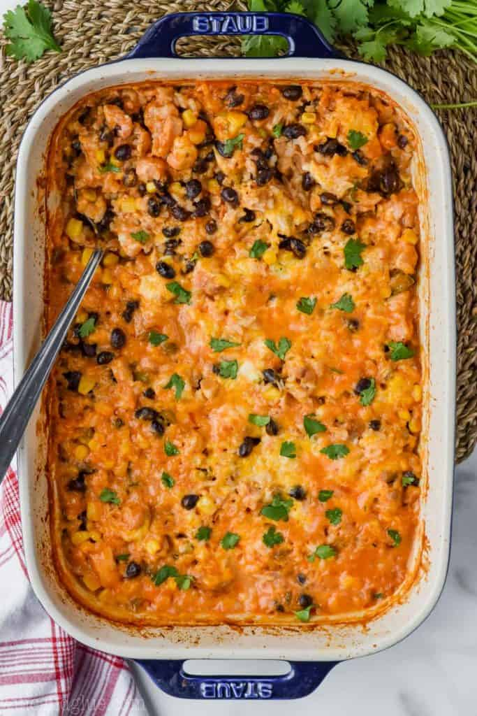 overhead of southwestern cheesy chicken and rice casserole in baking dish