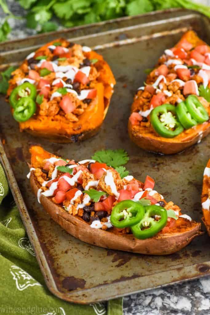 stuffed sweet potato recipe fixed like tacos on a baking sheet