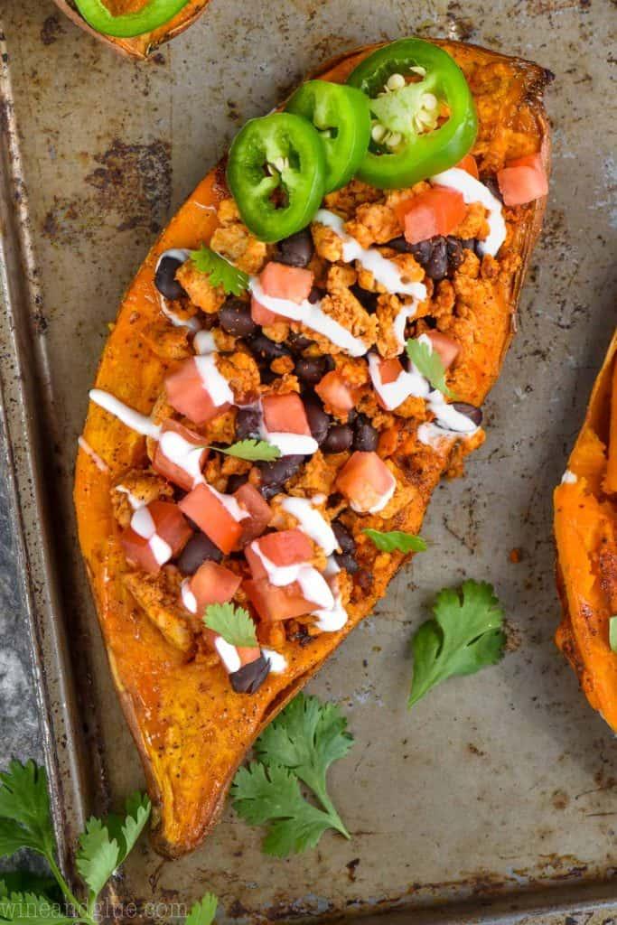 An overhead photo of the Taco Stuffed Sweet Potato stuffed with homemade taco seasoning, some lean turkey, and black beans.