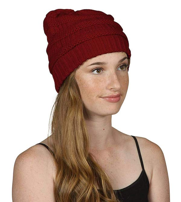 woman in a read knit beanie