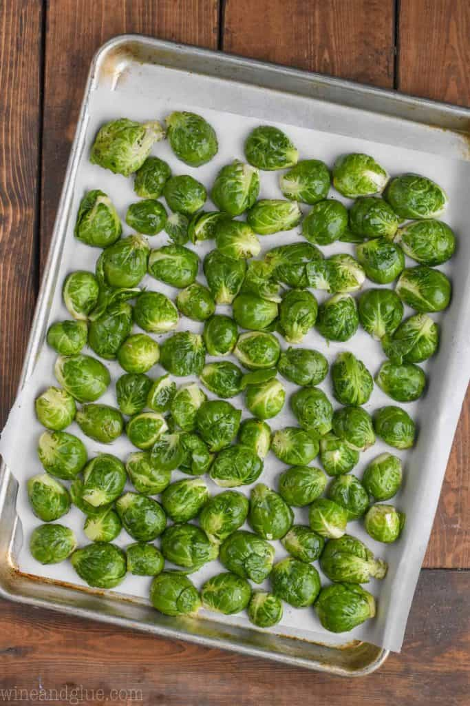 raw brussels sprouts on a baking sheet ready to be roasted