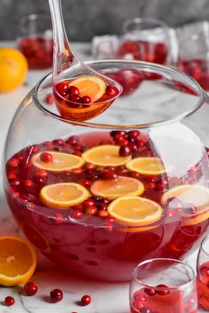 bowl of easy christmas punch recipe being ladled out of punch bowl
