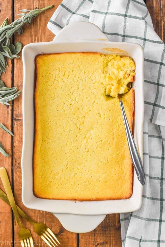 overhead of baked cream corn casserole in white casserole dish