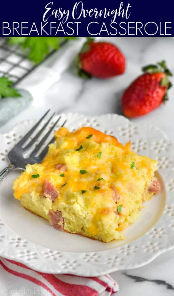 piece of ham and cheese overnight breakfast casserole on a white plate