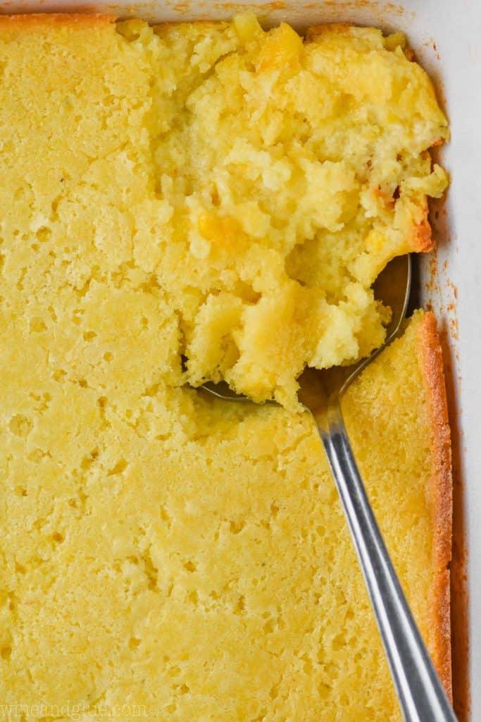 close up of spoon in casserole dish full of jiffy corn casserole