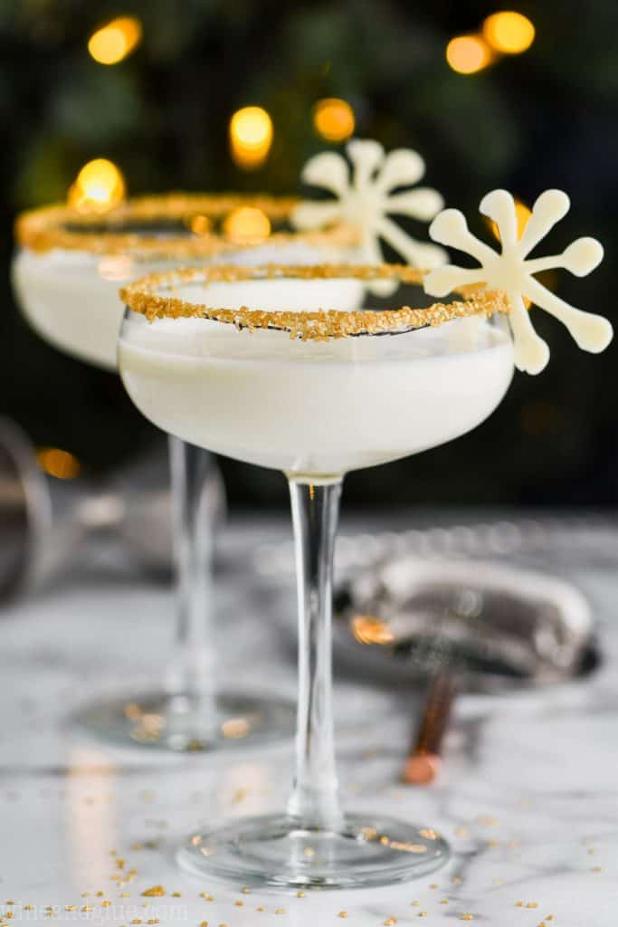 christmas martini in glasses rimmed with gold sugar