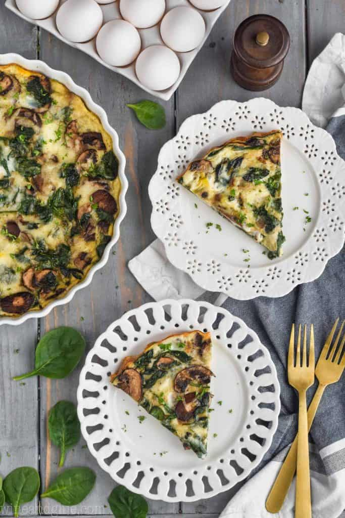 overhead view of two pieces of easy spinach quiche on white plates
