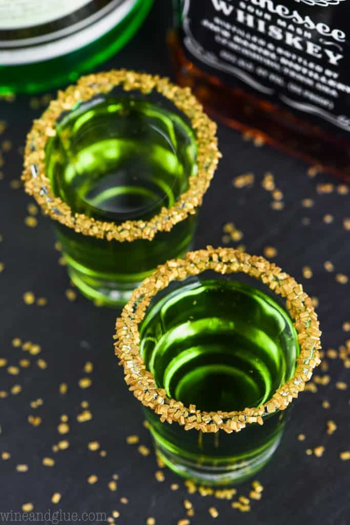 overhead shot of two shot glasses of lucky leprechauns shots