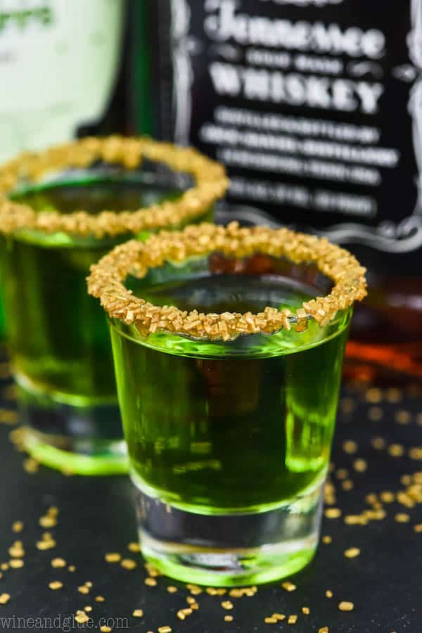st patrick's day two shot glasses of lucky leprechaun shots rimmed with gold sprinkles