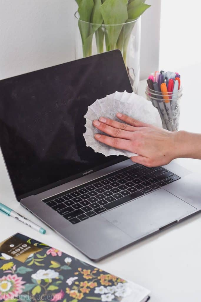 Using a coffee filter to clean dust off a computer screen.