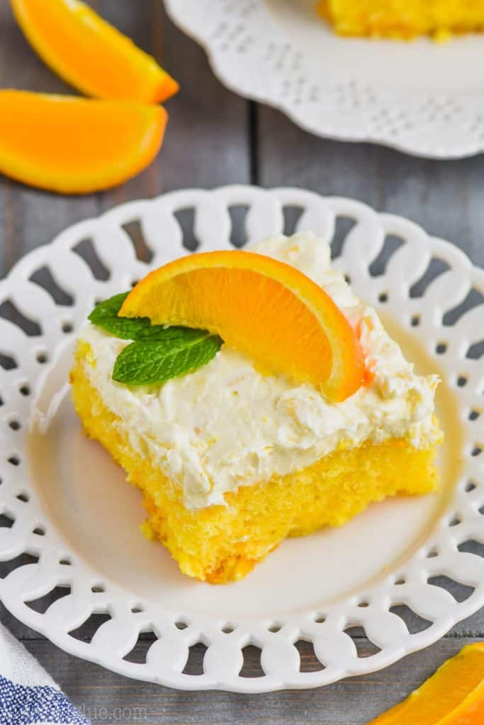 piece of orange cake on a white plate