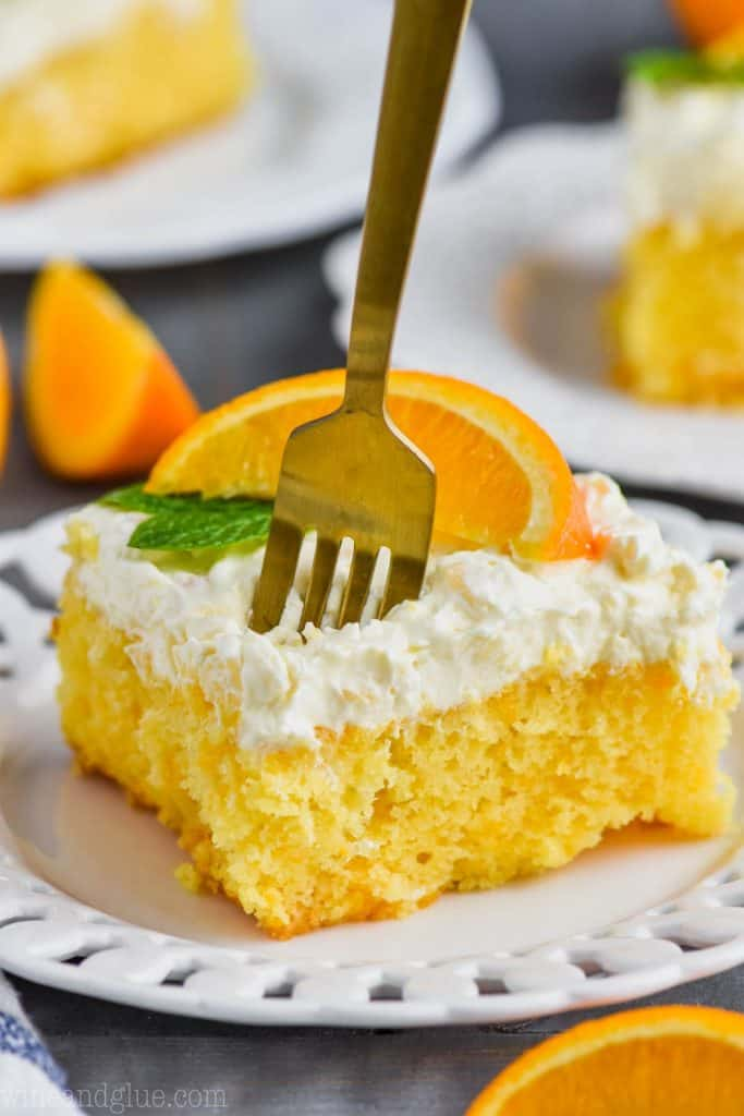 fork going into a piece of orange pineapple cake