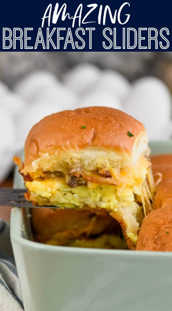 breakfast slider being pulled from casserole dish