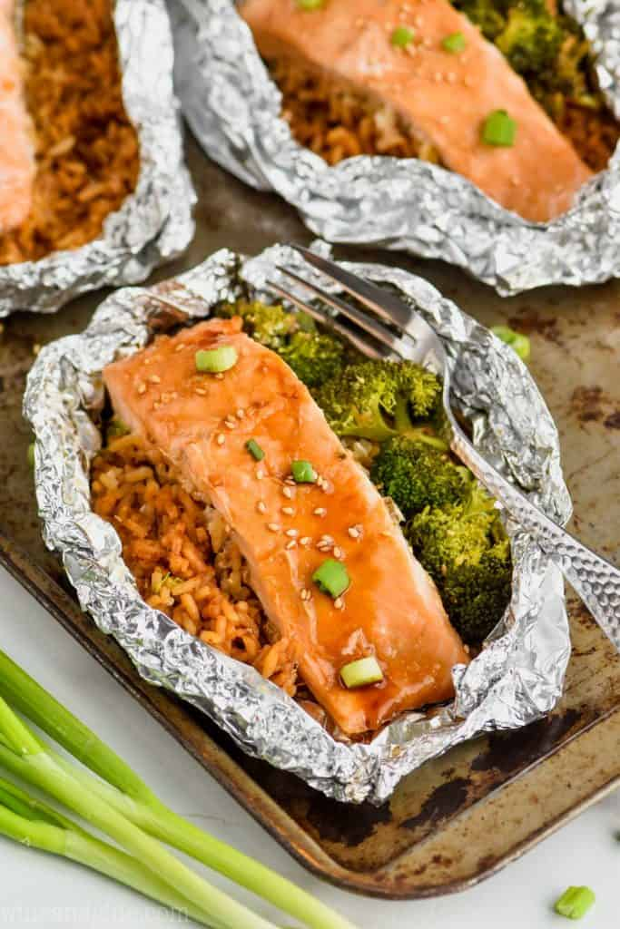 salmon foil packets with broccoli, rice, and teriyaki salmon