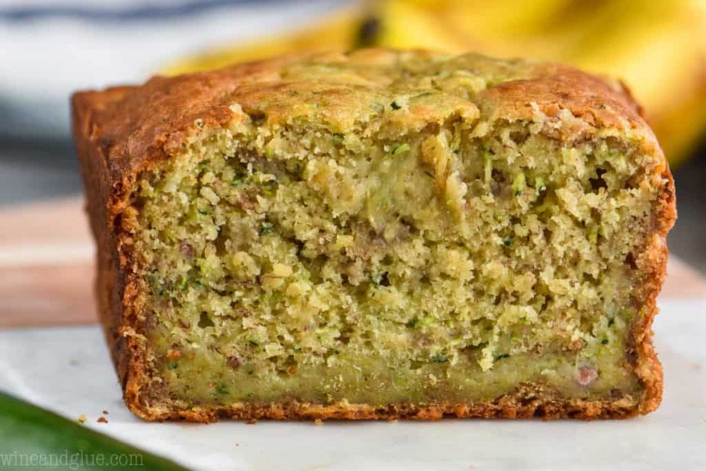 loaf of zucchini banana bread cut in half, showing the inside of the bread close up