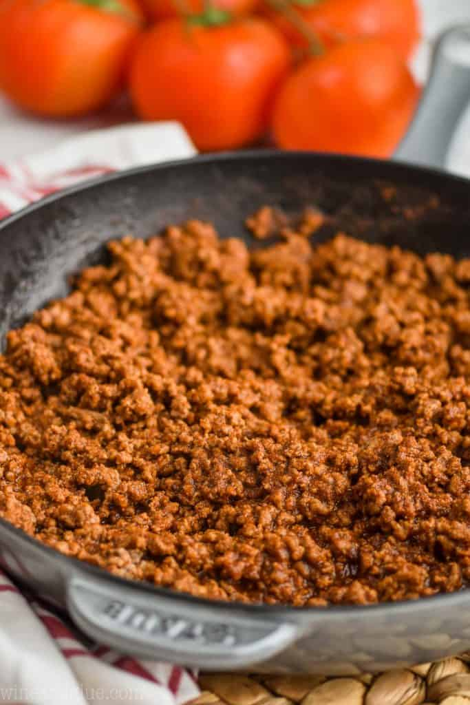 close up of homemade taco meat recipe in a staub gray pain that is fully cooked