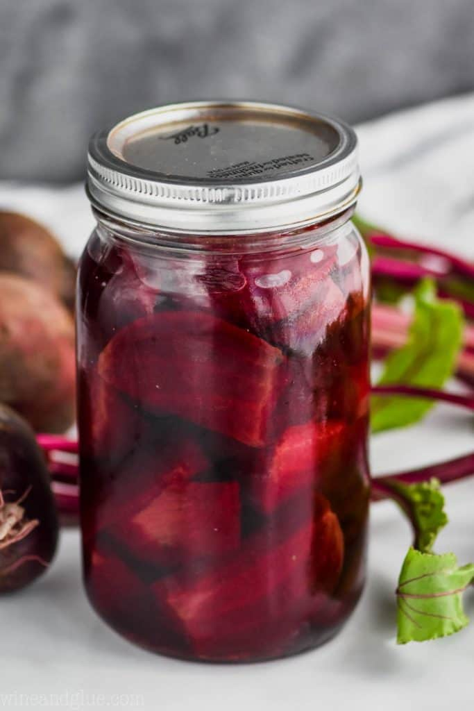 close up of a mason jar filled with refrigerator pickled beets
