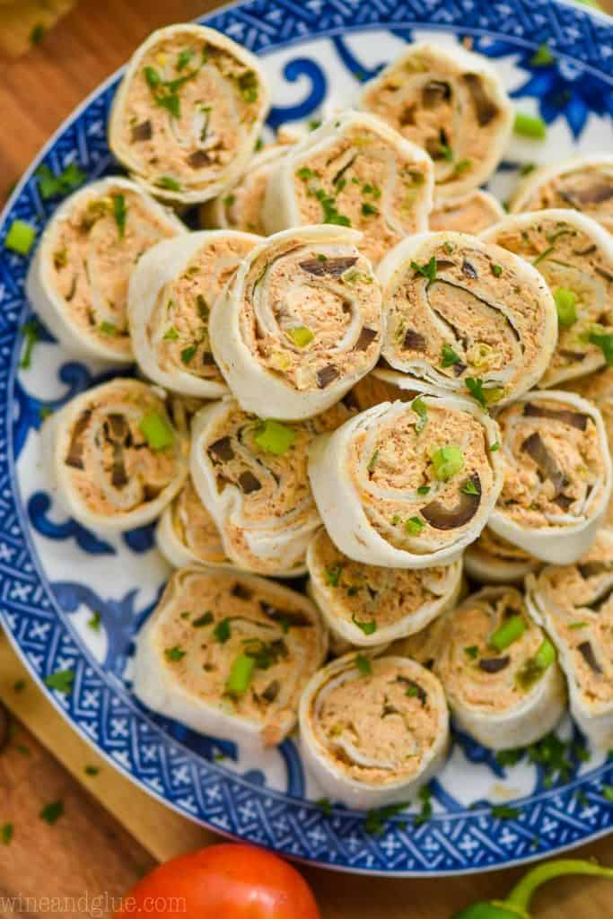 pile of taco pinwheel recipe on a blue and white patterned plate from above