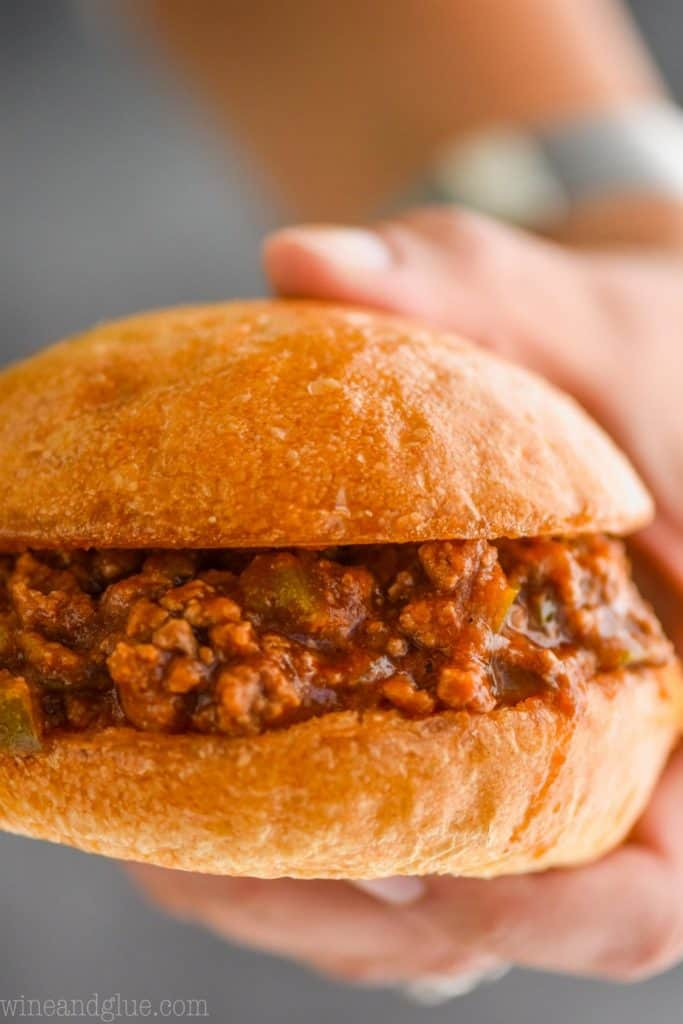 close up of a hand holding sloppy joe recipe