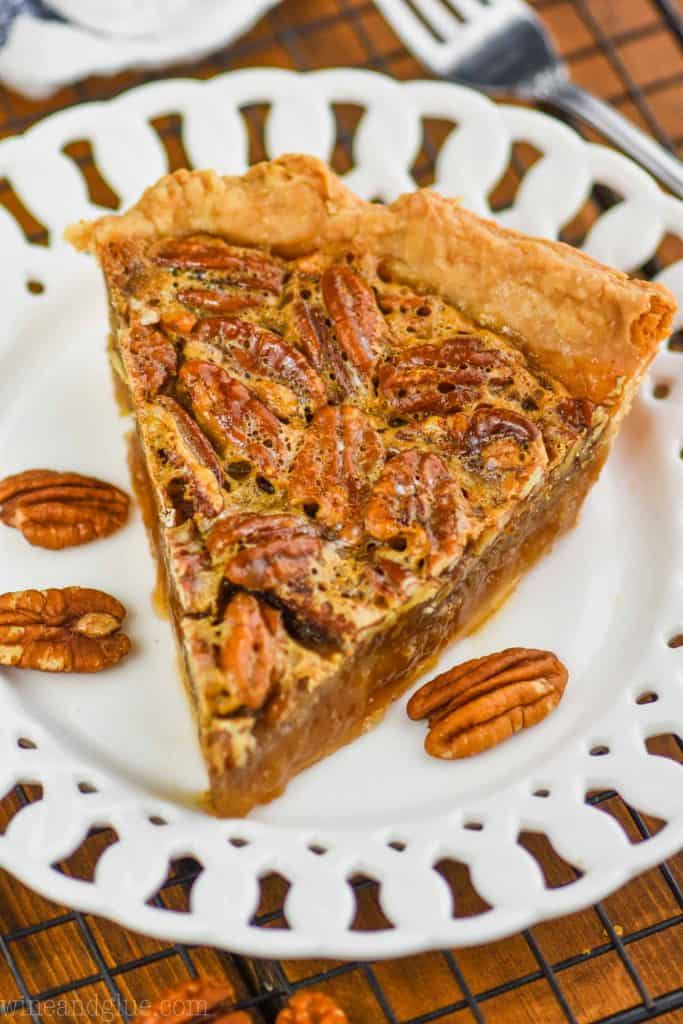 a single slice of easy pecan pie on a fancy white plate
