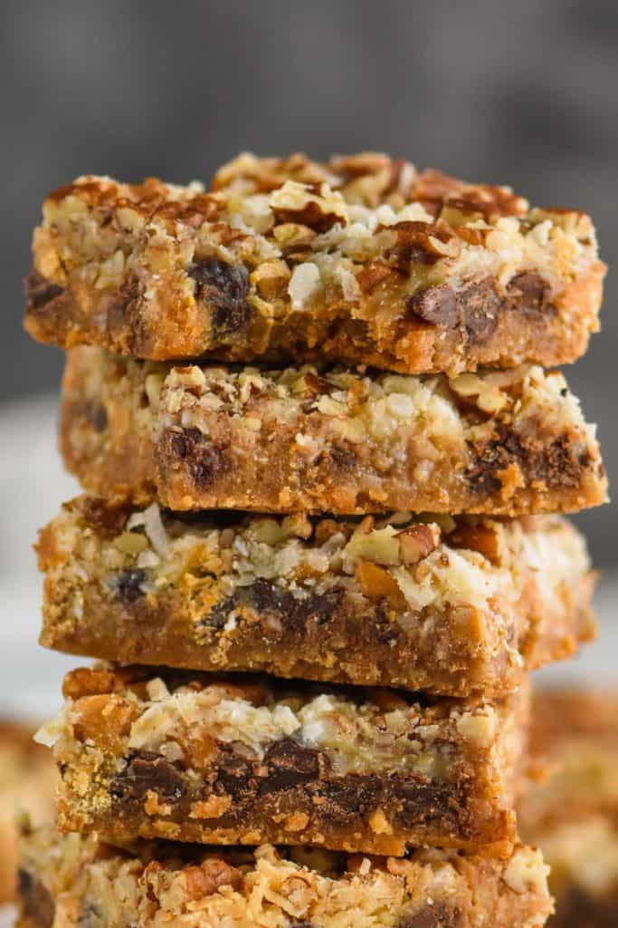 an up close picture of a stack of magic bars with a bite missing from the top one