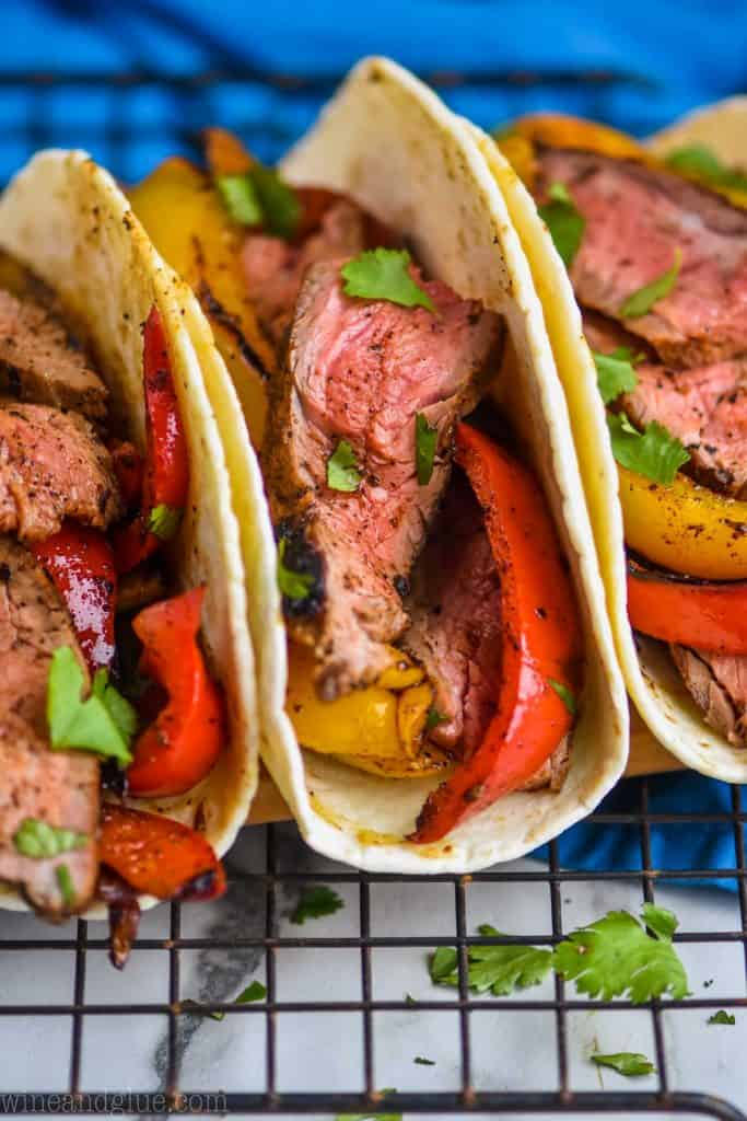 close up of three steak fajitas in tortilla shells