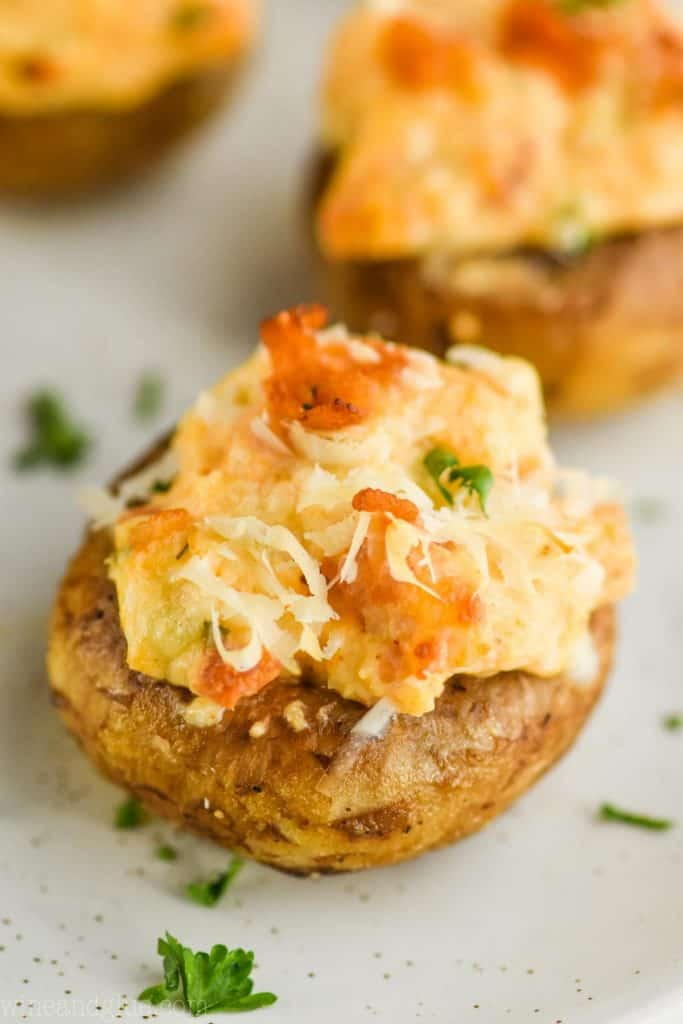 up close of stuffed mushrooms with cream cheese and bacon