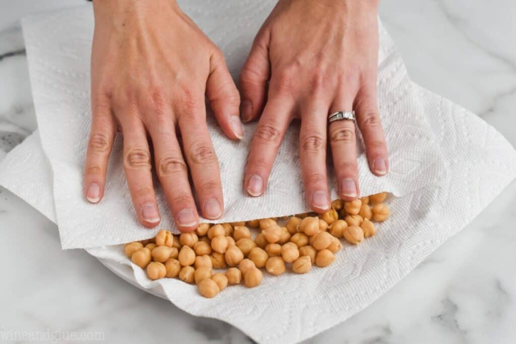 drying off chickpeas with a paper towel