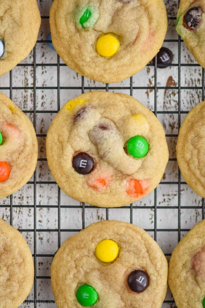 close up overhead photo of an m m cookie on a cooling rack