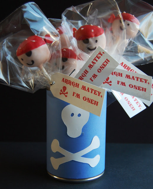 "Wrapped up Pirate Cake Pops with tags that says ""Arrgh Matey, I'm one!!"""