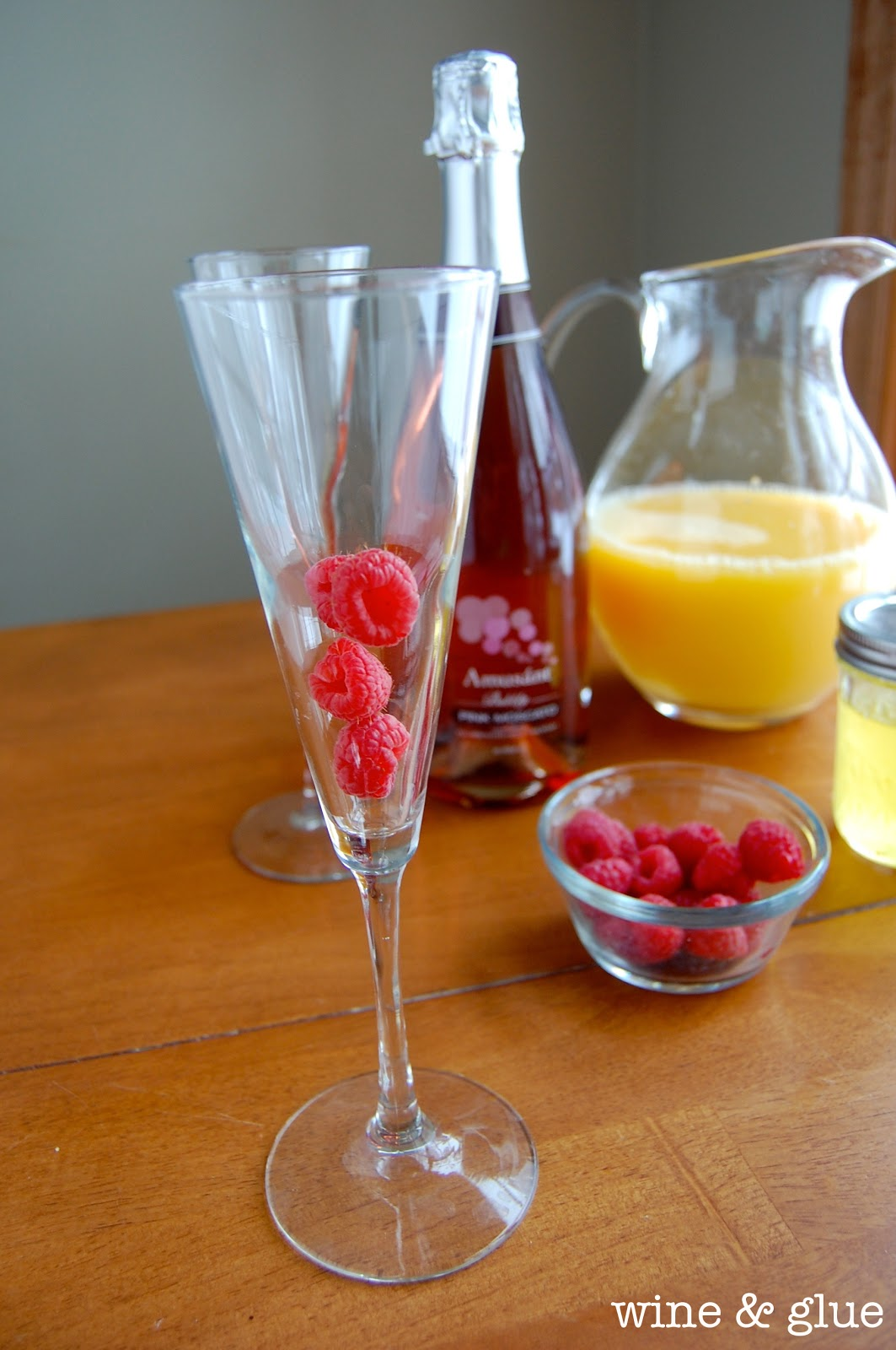 This Sunrise Mimosa cocktail is fruity, beautiful and totally refreshing. Super easy to make and tastes delicious!